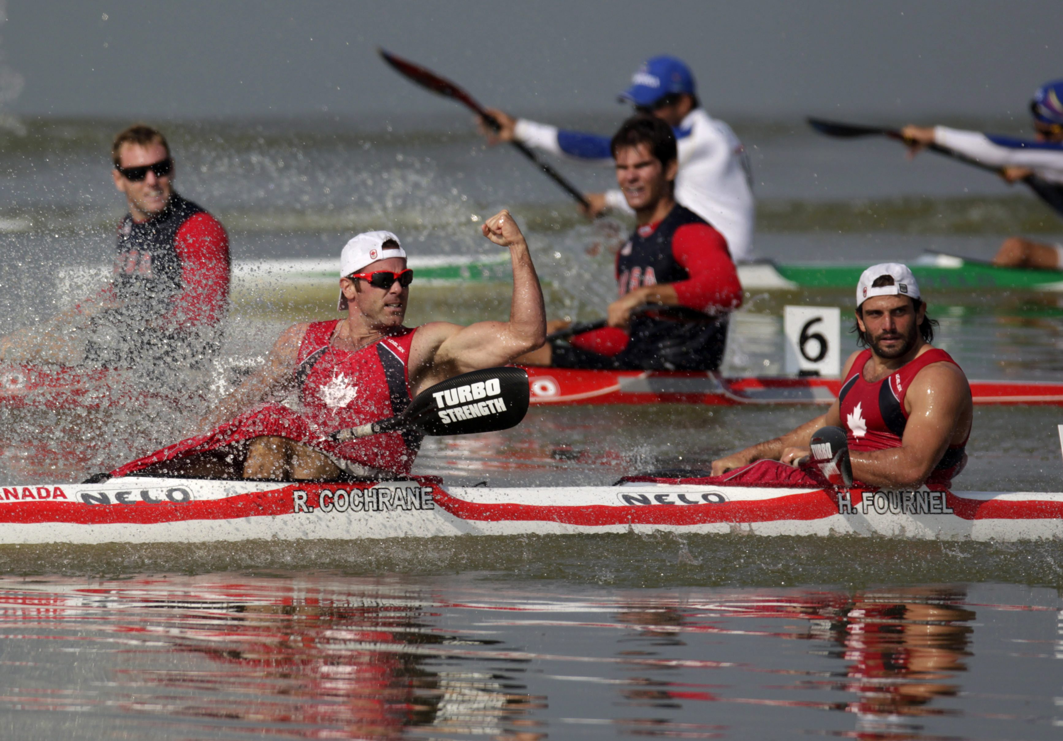 Gold medal winners Paul Cochrane, left, and Hugues Fournel from Canada cross the finish line as they win the men's double K2 200m kayak event at the Pan American Games in Ciudad Guzman, Mexico, Saturday Oct. 29, 2011. (AP Photo/Eduardo Verdugo)