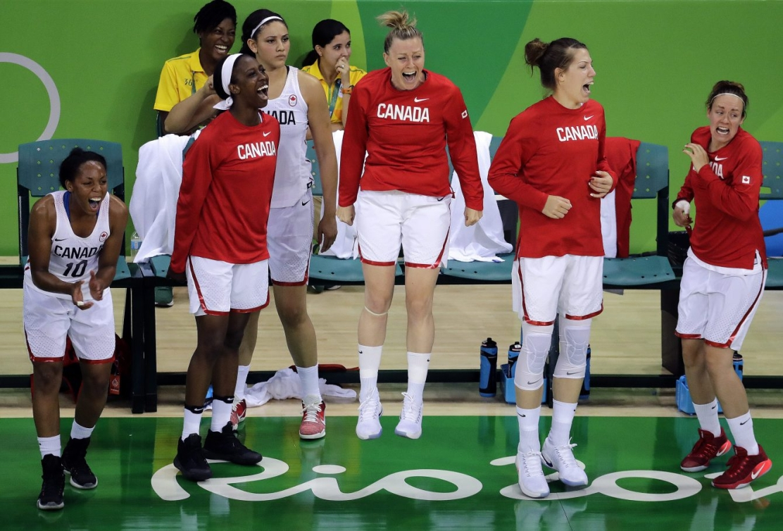 The Canadian bench celebrates after a teammate's basket during the second half of a women's basketball game against Serbia at the 2016 Summer Olympics in Rio de Janeiro, Brazil, Monday, Aug. 8, 2016. Canada won 71-67. (AP Photo/Charlie Riedel)