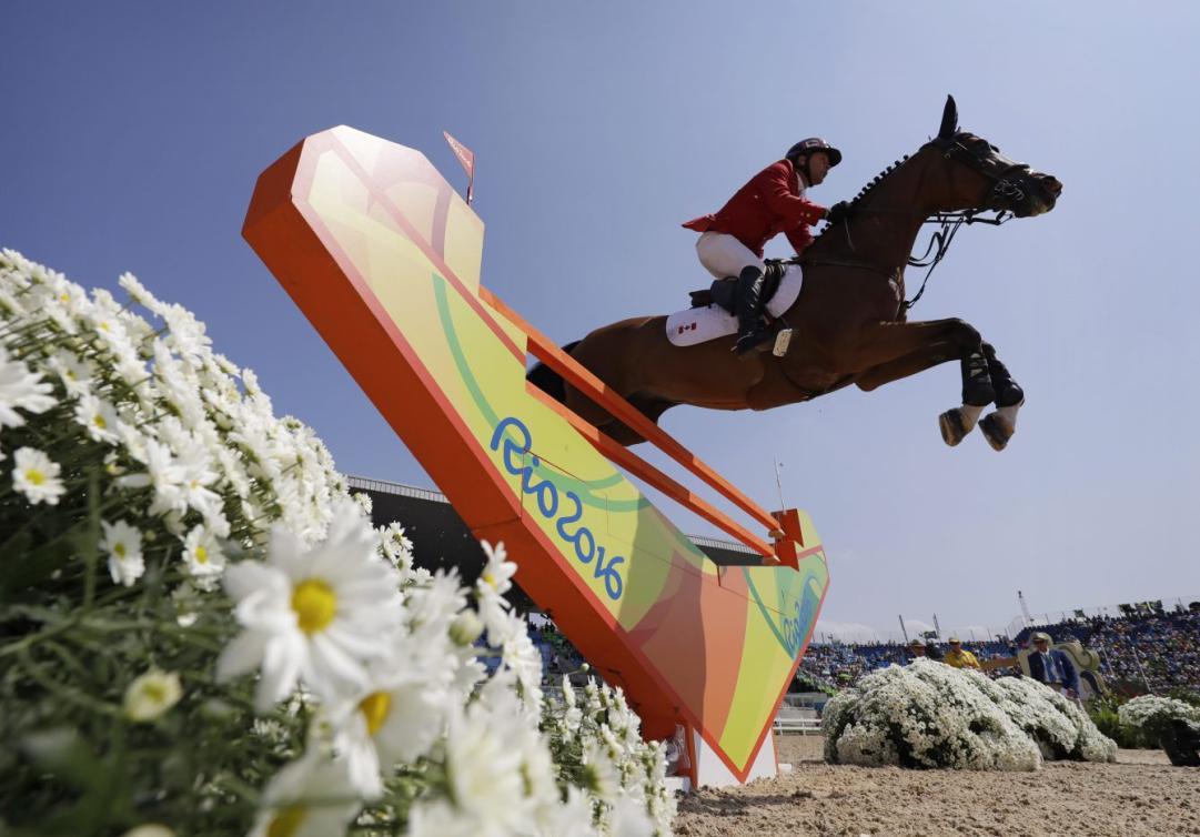 Eric Lamaze lors de la finale de saut d'obstacles aux Jeux olympiques de Rio, le 19 août 2016. (AP Photo/John Locher)