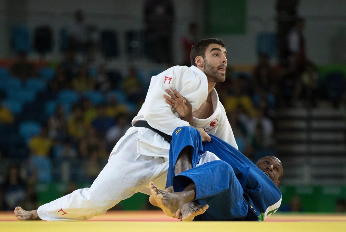 Antoine Bouchard contre Raymond Ovinou aux Jeux olympiques de Rio, le 7 août 2016. (COC Photo par Jason Ransom)