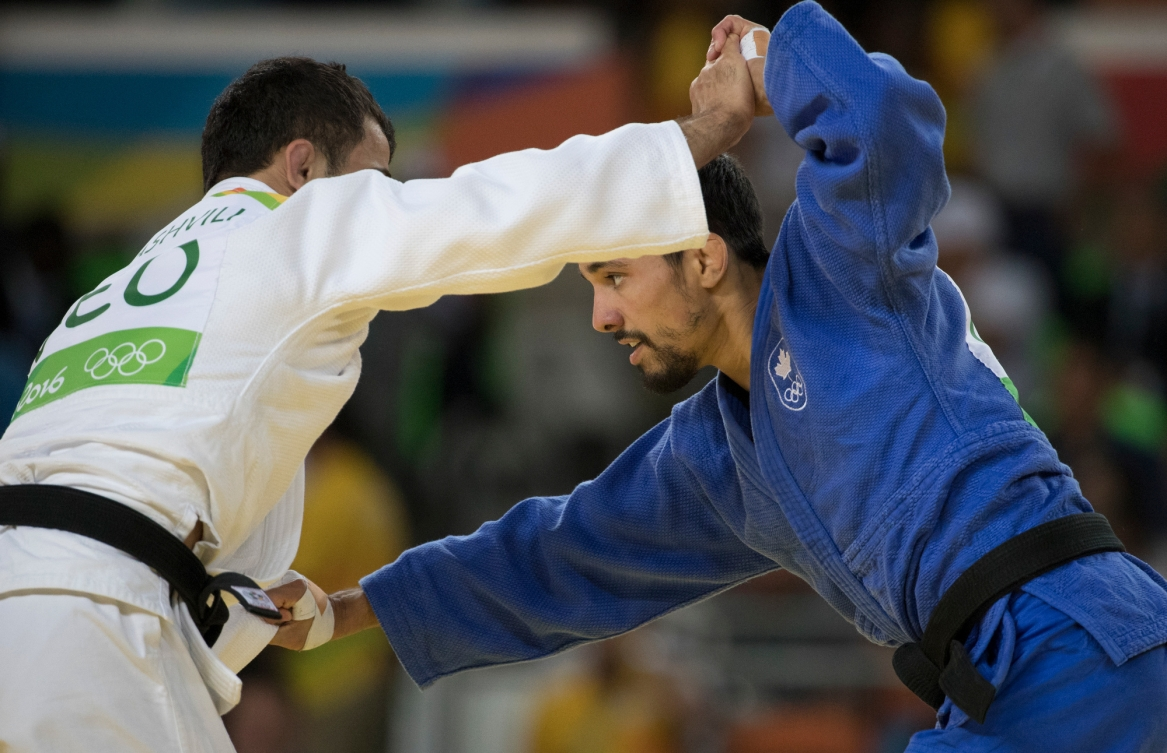 Canada's Sergio Pessoa battle with Amiran Papinashvili of Georgia in the 60kg judo event at the Olympic games in Rio de Janeiro, Brazil, Saturday, August 6, 2016. Pessoa lost the match and did not advance. COC Photo by Jason Ransom