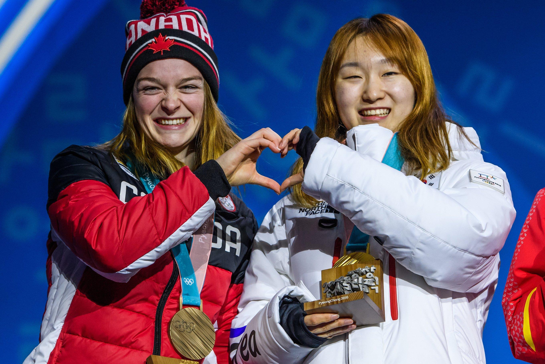 Kim Boutin reçoit sa médaille de bronze de l'épreuve 1500 m de courte piste aux Jeux olympiques de PyeongChang, en Corée du Sud, le 18 février 2018. (Photo by Vincent Ethier/COC)