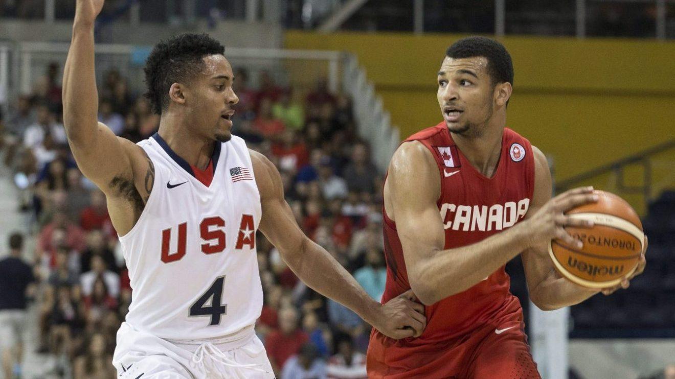 Le joueur canadien Jamal Murray est en possession du ballon lors des demi-finales du tournoi de basketball des Jeux panaméricains de Toronto, le 24 juillet 2015.